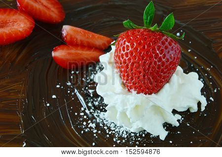 strawberries and wiping cream on the dark chocolate