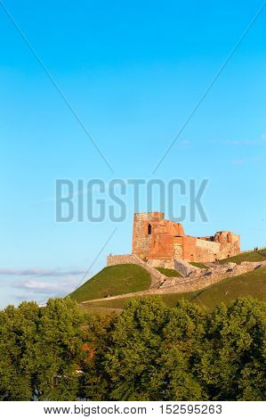 Vilnius, Lithuania. The Remains Of The Ancient Keep Fortress Of Upper Castle On Gediminas Hill, The Part Of The Famous Historical Castle Complex In Sunny Summer Day, Blue Sky Background.