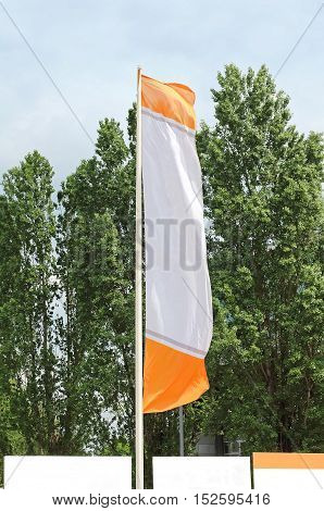 Empty banner flag flaunting on the wind outside