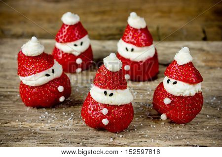 Cute edible santa dessert from strawberry and cheese cream funny idea for kids