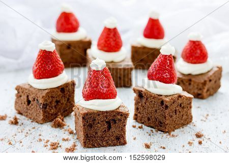 Santa Hat Brownie Bites with strawberries and whipped cream or frosting - great Christmas cookie swap idea