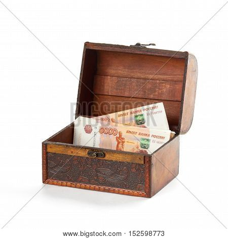 Small wooden chest is partially filled with russian money roubles.