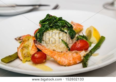 Shrimp Appetizer with Rice and Spinach and Asparagus