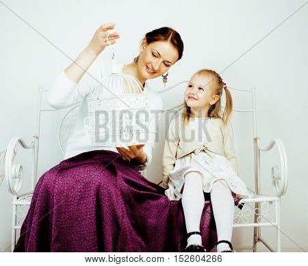 young mother with daughter at luxury home interior vintage, post card view happy smiling people close up