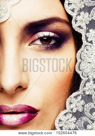 beauty young woman throw white lace close up, bride under veil, real bride, makeup and nails close up macro