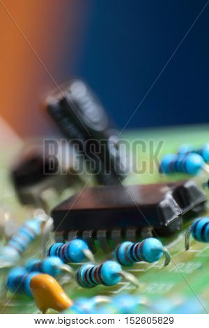Electronic components on circuit board taken closeup.