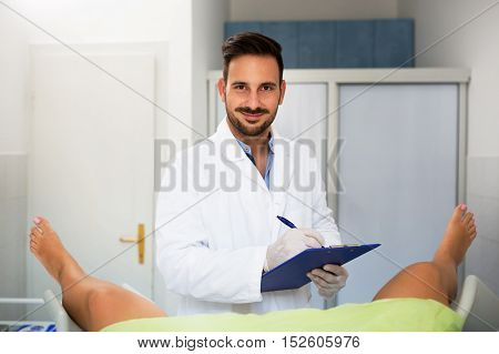 Young Male Doctor Gynecologist Check Up His Patient