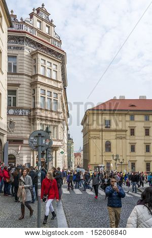 PRAGUE, OCTOBER 15: Mostecka Street leading up to the famous Charles Bridge on October 15, 2016 in Prague, Czech Republic. Prague is full of beautiful historic buildings.