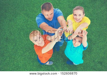 Group of young people with hands in stack