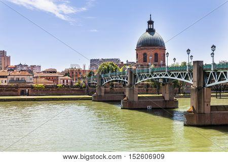View of Toulouse, France with Saint-Pierre Bridge over Garonne river and Dome de la Grave