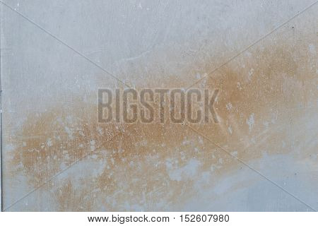 Image of a concrete wall in shades of grey and brown, suitable for use as a background or texture.