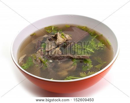 Boiled offal Put them in a bowl Placed on a white background.