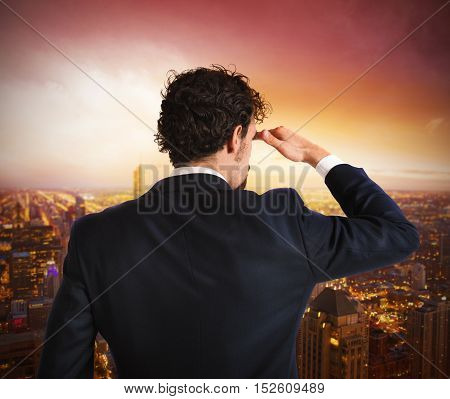Businessman view from above view of the city during the sunrise