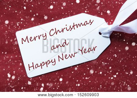 One White Label On A Red Textured Background. Tag With Ribbon And Snowflakes. English Text Merry Christmas And Happy New Year