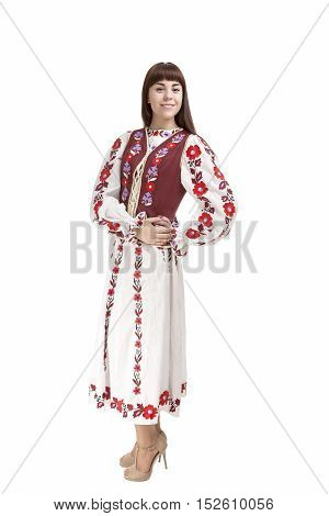 Full Length Portrait of Happy Smiling Brunette Woman Posing in Unique Hand-Made Flowery National Costume Dress. Against Pure White Background. Vertical Shot