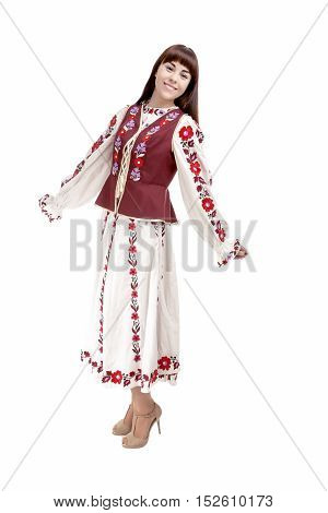 Full Length Portrait of Happy Smiling Brunette Woman Posing in Unique Hand-Made Flowery National Costume Dress. Against Pure White Background. Vertical Image Composition