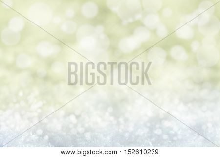 Golden Christmas Texture With Snow. Magic Bokeh Effect With Lights. Copy Space For Advertisement. Card For Seasons Greetings