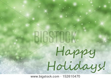 English Text Happy Holidays. Green Sparkling Christmas Background Or Texture With Snow. Copy Space For Your Text Here