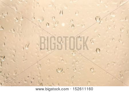 Drops of rain on glass , rain drops on clear window / water drops on glass after rain background / water drops / Small water drops on the glass