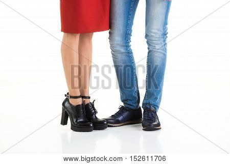 Woman's and man's legs on an isolated studio background