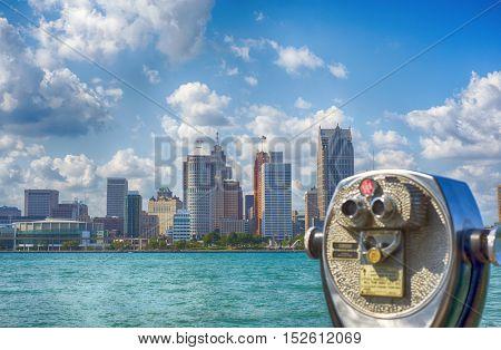 Binoculars overseeing Detroit city skyline from Windsor, Ontario