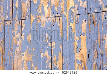 Background of peeling paint covered with wooden planks