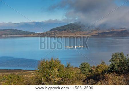 Amazing Autumn Landscape with Low clouds over water of Batak Reservoir, Pazardzhik Region, Bulgaria