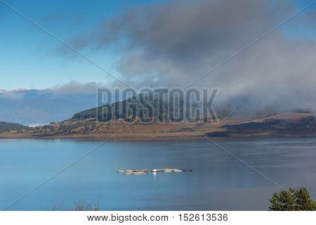 Amazing Autumn panorama with Low clouds over water of Batak Reservoir, Pazardzhik Region, Bulgaria