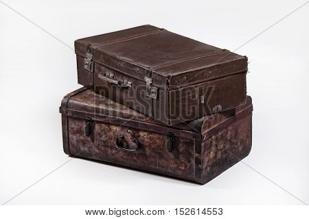 Two old suitcases on an isolated studio background