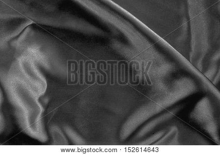 Black Texture Dark Wavy Glossy Silk Drapery for background.