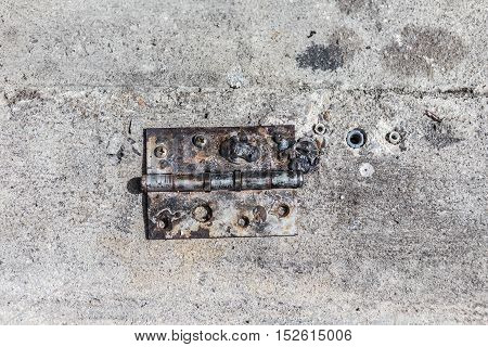 Old Steel hinge on concrete ground as street.