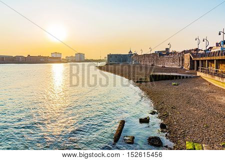 Seafront of portsmouth with sunset and sea
