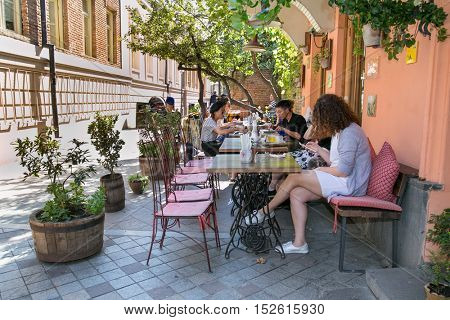 TBILISI, GEORGIA - OCT 6, 2016: People sit in the cafe next to the Marionette Tower in Tbilisi, on Oct 6, 2016, Georgia. Europe.
