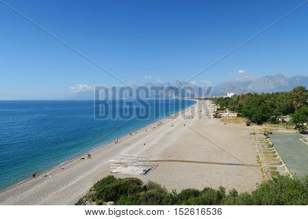 The 100m wide Konyaalti Beach on a Spring Day in Antalya with the Taurus Mountains in the Background