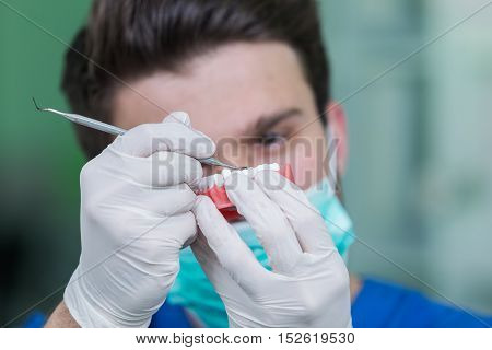 Dental Prosthesis, Dentures, Prosthetics Work. Prosthetics Hands While Working On The Denture, False