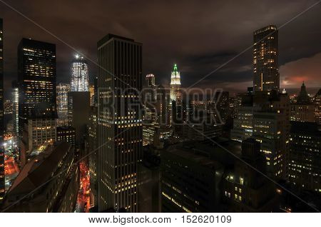 Aerial View of the skyscrapers of downtown Manhattan in New York City at night.