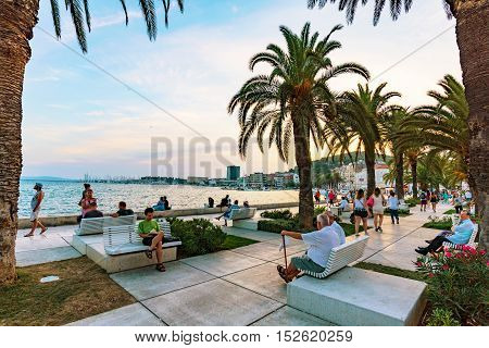 SPLIT CROATIA - SEPTEMBER 17: Seafront promenade in Split in the evening near the old town center where many tourists come to walk and relax on Seteptember 17 2016 in Split