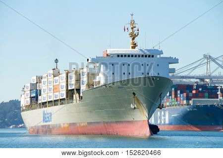 Oakland CA - September 27 2016: Matson Cargo Ship KAUAI entering the Port of Oakland. Matson provides shipping services Pacific wide. Mainly to and from the Hawaiian Islands.