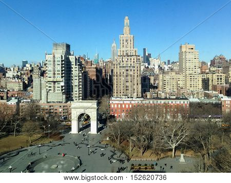 Aerial view of Washington Square Park looking North unto Midtown Manhattan of New York City.