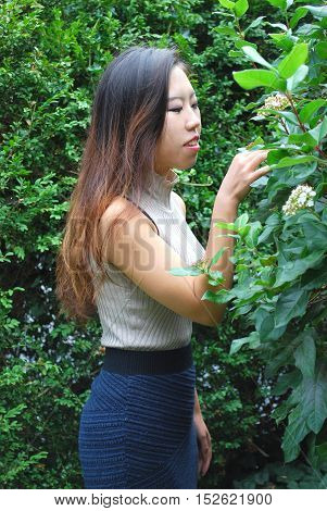 Asian female beauty fashion model expressions outside alone.