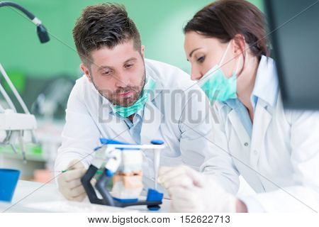 Closeup Of Dentistry Student Practicing On A Medical Mannequin