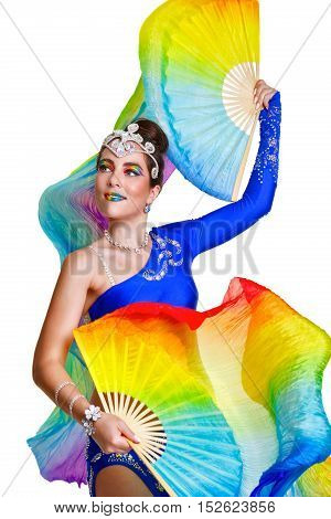 Attractive girl dances with two rainbow fans. Stage makeup and image.