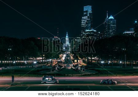 night time shot in Philadelphia from the Rocky steps at the art museum of the benjamin franklin parkway