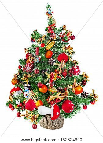 Christmas fir tree decorated with toys and Christmas decorations isolated on white background.