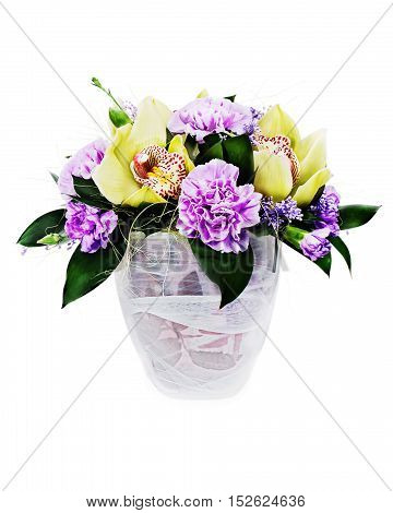 Colorful floral bouquet of roses,cloves and orchids arrangement centerpiece in glass vase isolated on white background.