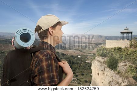 Young man with a travel backpack
