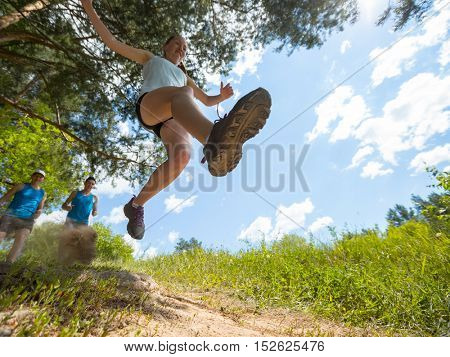 Trail running athlete jumping
