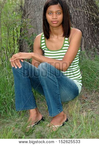 African american female beauty expressions outdoors in nature.