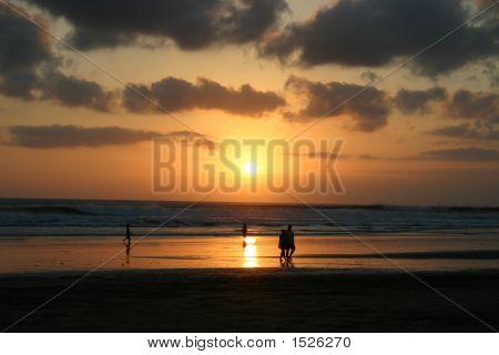 Sunset Over A Sandy Beach