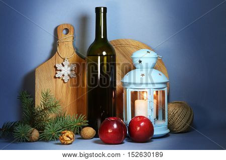 Christmas still life with apples, candle and boards